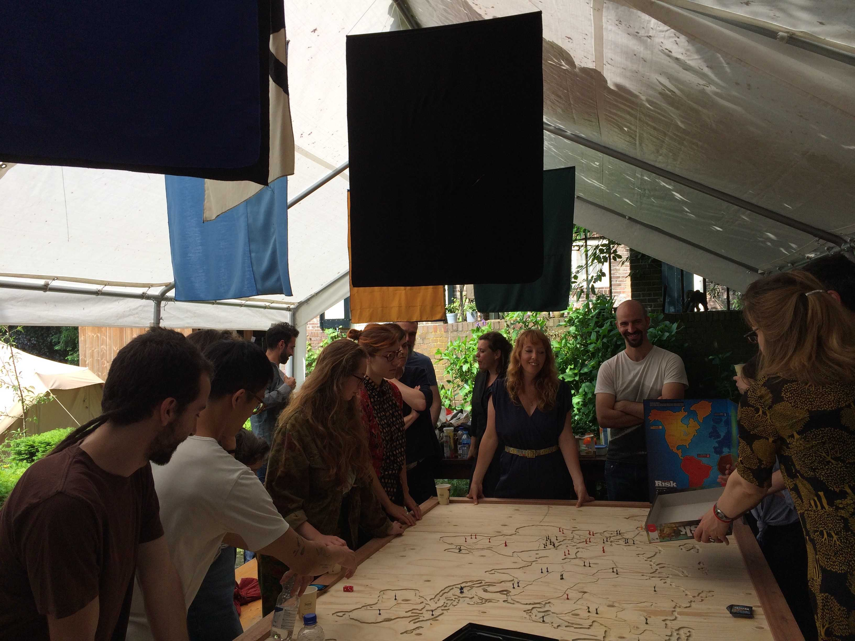 """I left my pdf in Bandung"" presents participants of the Location Location Location research group of the Roaming Academy (led by Sarah Pierce and Tirdad Zolghadr): an epic ongoing game of Risk."