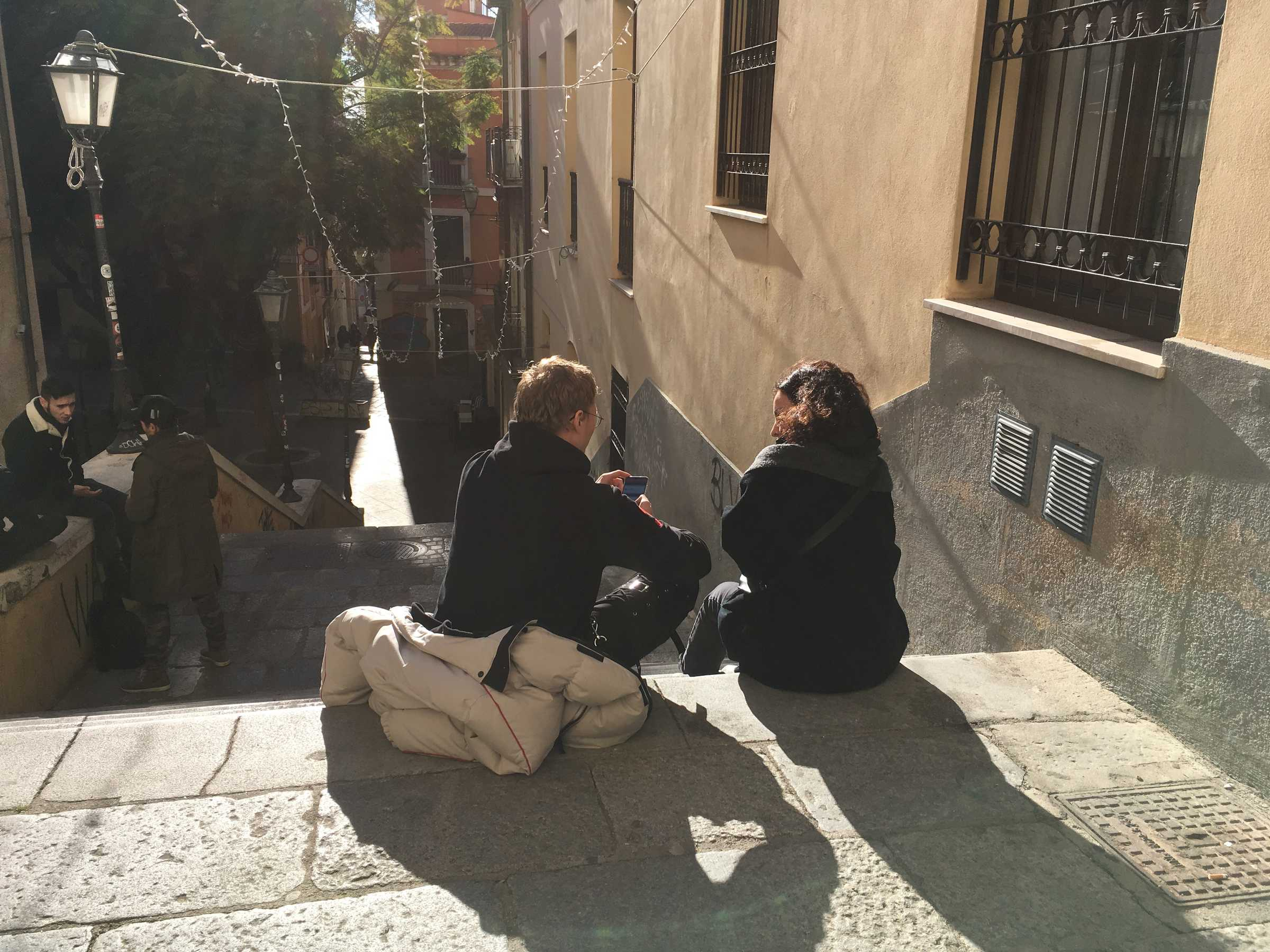 How To Do things With Theory ~ face to face meeting Ghalya Saadawi and Nilz Källgren, in the streets of Cagliari. DAI week 4, January 2019. Photo: Jacq van der Spek.