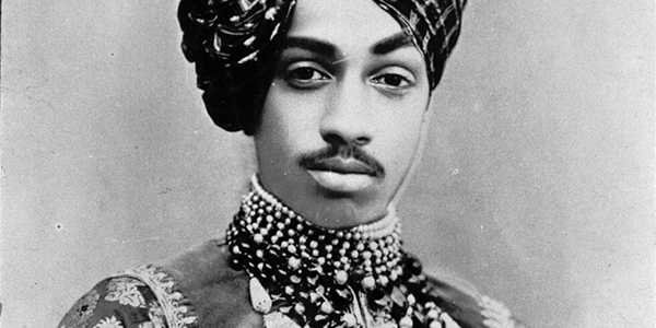 This portrait of Maharaja Sardar Singh was probably made in Jodhpur around 1900. Born in 1880, Sardar succeeded his father Jaswant Singh in 1895, at the age of 15, as Maharaja of Jodhpur. In the photo, Sardar is wearing the court dress and precious jewelry that pertains to his position as Maharaja. The turban alone is a badge of honor and a status symbol. More striking, however, is the ornament, the 'shast', that has been applied to it. It consists of a painted portrait of Sadar's father, set entirely in gold and trimmed with pearls. This tradition dates back to the Mughal period and only the most eminent were granted the privilege of wearing the portrait of the Maharaja. By wearing this 'shast' Sadar expresses, very consciously, both his strong sense of belonging to - and respect for - the memory of Jaswant Singh. His father died in 1895. But not only through the miniature portrait is Sardar connected with his father. The necklaces of rows of pearls and (uncut) diamonds, together called 'kantho', were also worn by Jaswant Singh on important occasions and recorded on the painted portraits known of him. The portrait thus contains many clues through which the person portrayed expresses his connection with the royal line of Jodhpur. Maharaja Sardar Singh ruled until his death in 1911 after which the regalia passed to his first son, Sumer Singh. We add this image to this conversation to discuss the attempts to curate differently and to question how we care for images and objects that are embedded in the pasts and structures that we aim to address through the attempts of curating and collecting differently.